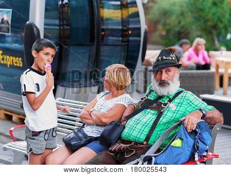 Senior People Sitting On Bench