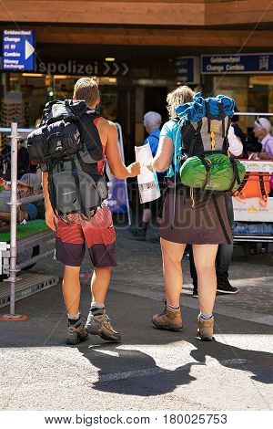 Tourists Backpackers With City Map