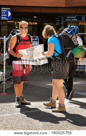 Tourists Backpackers Looking Into City Map