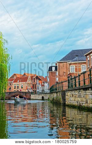 Tourists On Boat At Graslei In Lys River In Ghent