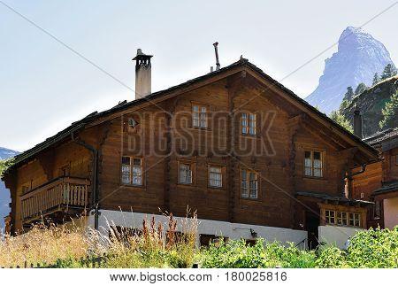 Traditional Swiss Chalet At Zermatt With Matterhorn Summit