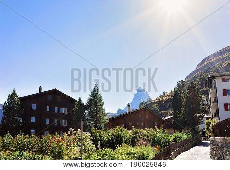 Traditional Swiss Chalets In Zermatt And Matterhorn Summit