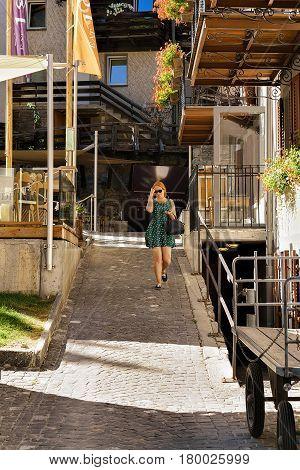 Young Woman At City Center Of Zermatt In Summer