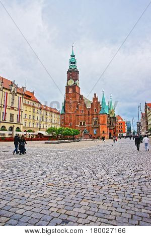Tourists At Old Town Hall At Market Square Of Wroclaw