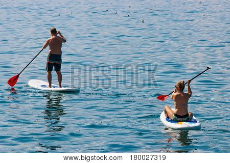 Couple On Standup Paddle Board On Geneva Lake Montreux
