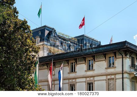 Facade Of Luxury Hotel With Swiss Flag At Montreux