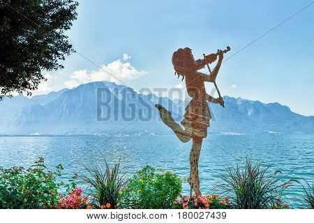 Figure Of Girl With Violin At Geneva Lake In Montreux