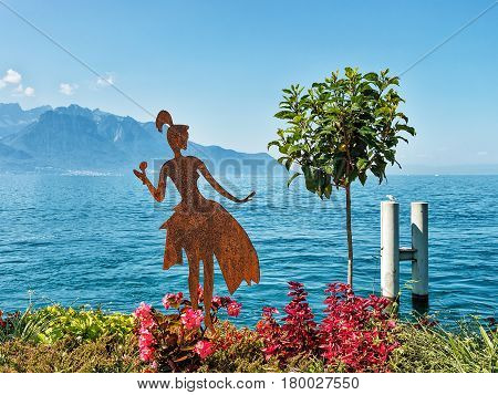 Figure Of Woman On Promenade Of Geneva Lake In Montreux