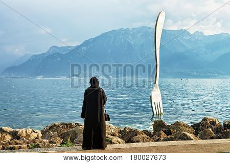 Muslim Woman At Fork Sculpture At Geneva Lake In Vevey