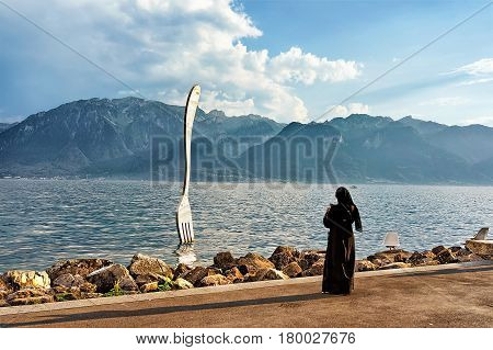Muslim Woman At Fork Sculpture At Geneva Lake Of Vevey