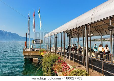 People At Landing Stage At Geneva Lake In Montreux