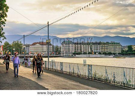 People On Embankment Of Geneva Promenade Du Lac