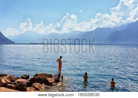 People Swimming In Geneva Lake In Montreux
