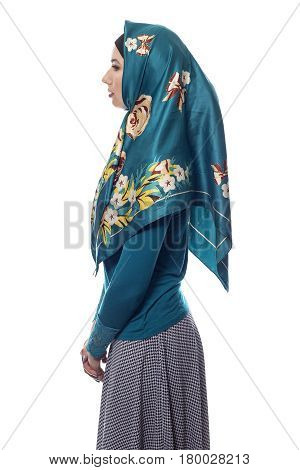 Fashion model wearing hijab for conservative modern clothing on a white background. The style is associated with muslims middle eastern and east european culture.