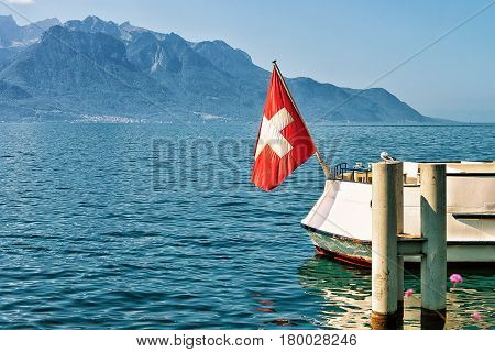 Boat With Swiss Flag At Geneva Lake In Montreux