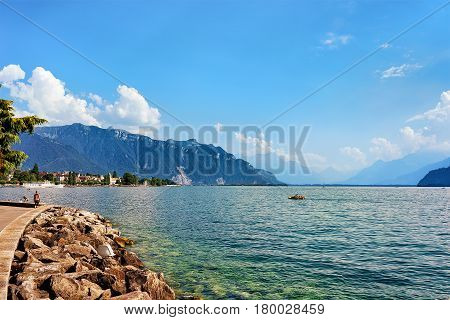 Embankment With Alps Mountains And Geneva Lake Riviera In Vevey