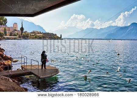 Muslim Woman Standing At Pier In Geneva Lake In Montreux
