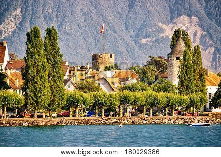 Town With Towers And Alps Mountains And Geneva Lake Vevey