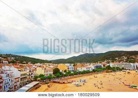 Beach And People At Tossa De Mar On Costa Brava