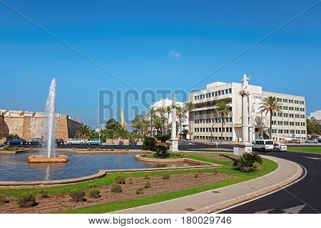 Constitution Square With Fountain And City Walls In Cadiz