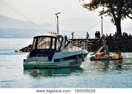 People In Catamaran And Motor Boat At Geneva Lake Lausanne