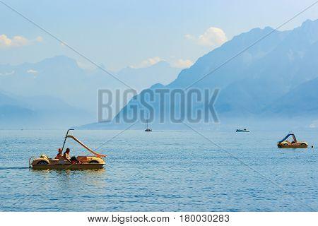 People In Catamarans At Geneva Lake In Lausanne