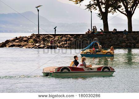 People In Catamarans At Lake Geneva In Lausanne