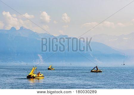People In Catamarans In Geneva Lake In Lausanne