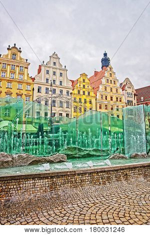 Fountain at the Market Square in Wroclaw Poland. Tower of St Elizabeth Tower on the background