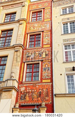 Gdansk Poland - May 7 2014: Historical building decorated with painting in the old town center Gdansk Poland