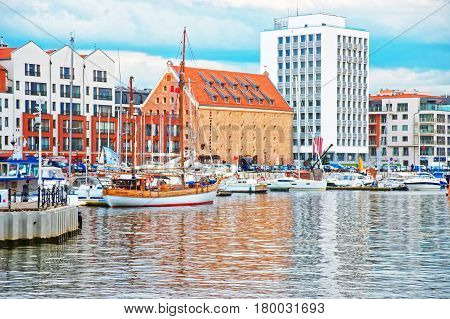Old Port With Boats At Waterfront Of Motlawa River Gdansk