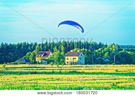 Paraglider Flies Over With Parachute In Poland