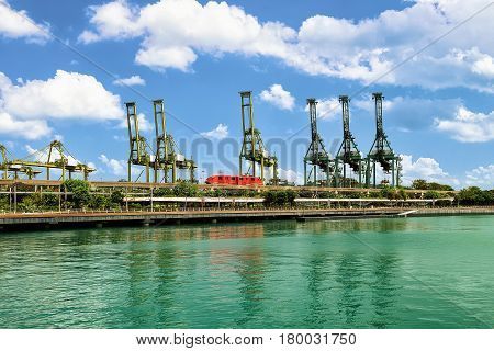 Passenger Express Train And Loading Cranes On Sentosa Island Singapore