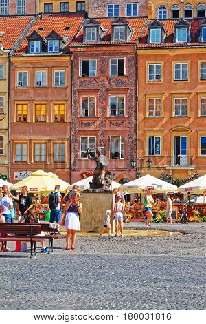People At Mermaid On Old Town Market Square In Warsaw