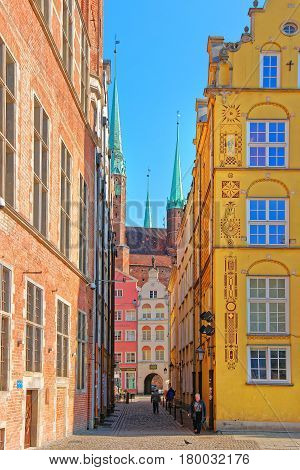 Street And Fragment Of Saint Mary Basilica Gdansk