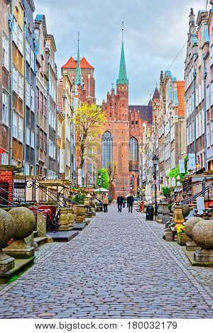 Street And Fragment Of St Mary Basilica In Gdansk