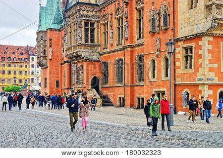 Tourists At Old Town Hall Of Market Square In Wroclaw