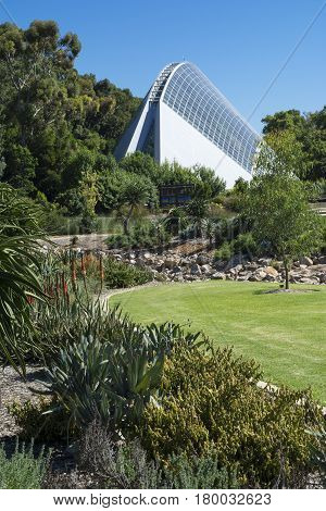 Adelaide South Australia Australia: March 19 2017 - Adelaide Botanic Garden Bicentennial Conservatory in the background with the garden grounds in the foreground.