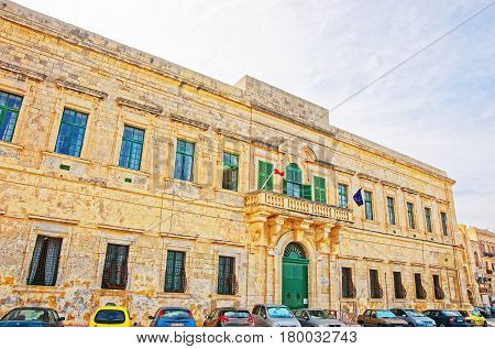 Governmental Building With Flags In Valletta Old Town
