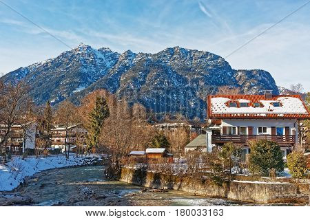 Alps Partnach River And Wooden Chalets In Garmisch Partenkirchen