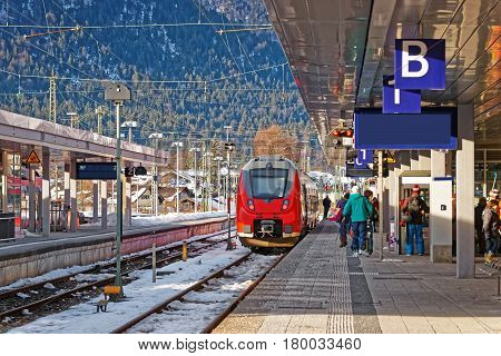 Passengers And High Speed Train In Garmisch Partenkirchen Germany