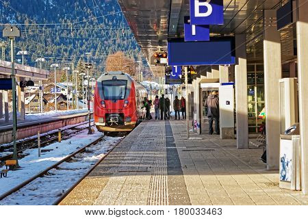 Passengers And High Speed Train In Garmisch Partenkirchen In Germany