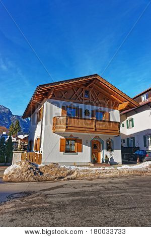 Street With Chalet And Alps In Winter Garmisch Partenkirchen