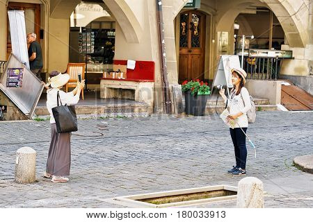 Asian Women Tourists At Kramgasse Street In Bern