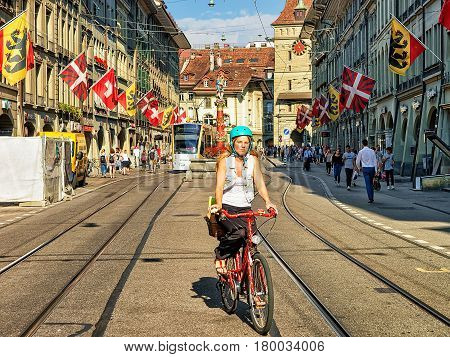 Girl On Bicycle At Piper Fountain On Spitalgasse In Bern