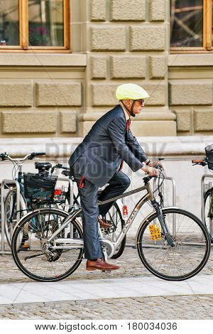 Man In Suit Riding His Bicycle In Bern