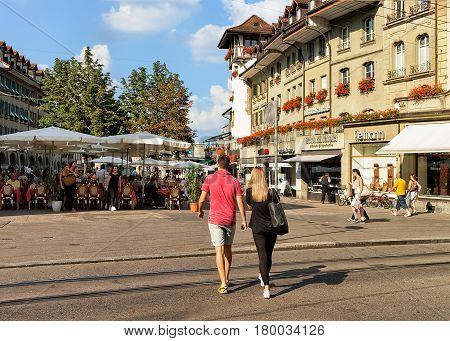 People At Marktgasse Street With Open Air Cafes In Bern