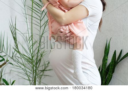 Pregnant woman with child pregnancy bellymother and daughter. Happy motherhood. Expecting baby birth in third trimester being mother. Prenatal period pregnancy health prepared for child birth