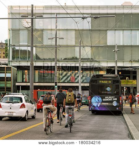 People Bicycle And Bus At Train Station On Bahnhofplatz Bern
