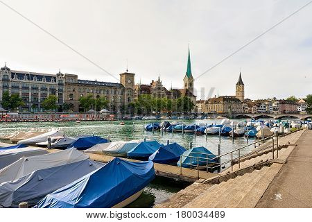 Boats At Limmat And St Peter And Fraumunster Church Zurich